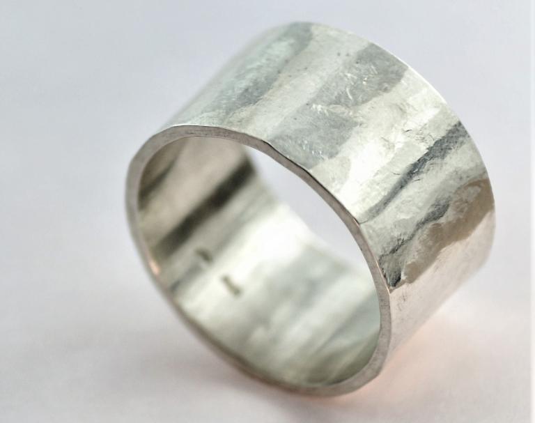 zilveren damesring/herenring breed